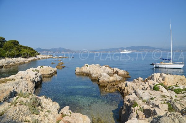 Cove in St Honorat with view on Cannes and Estérel