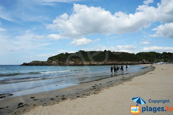 Surfers on the beach of St Lunaire