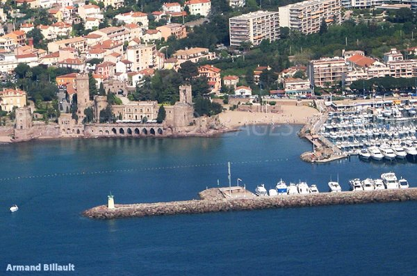 Photo of Castle beach in Mandelieu in France with the harbor