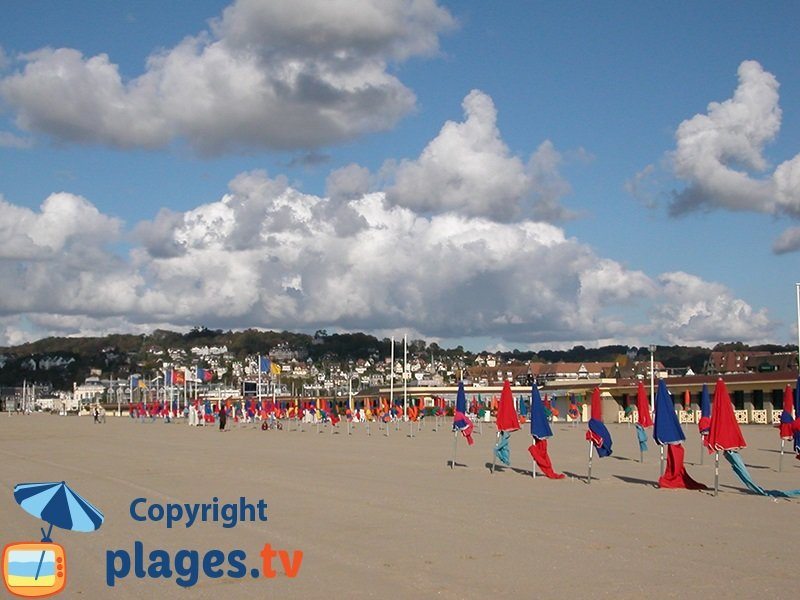 Beautiful Deauville beach with parasols