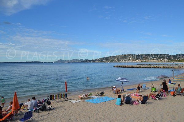 Sand beach in Juan les Pins and Esterel massif view