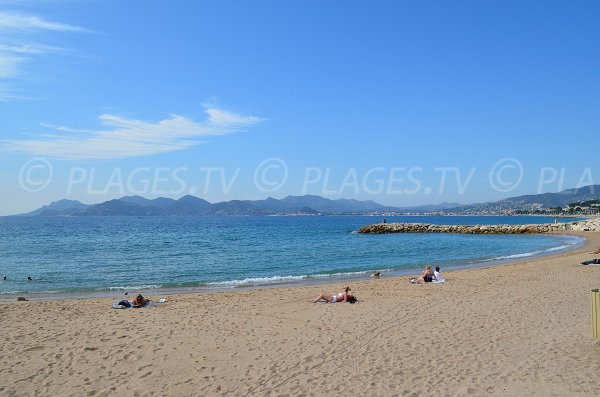 Midi beach in Cannes and view on the Esterel massif