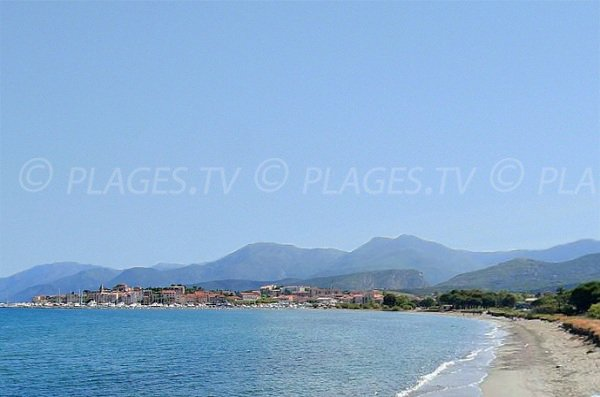 End of Roya beach and view on St Florent
