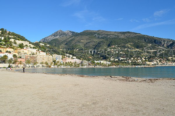 Sablettes beach in Menton and view on Italy