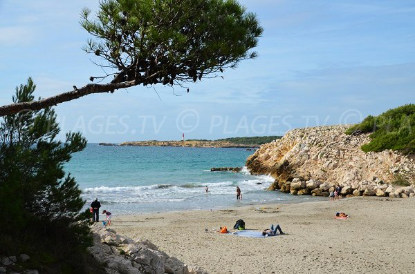 Photo of Ste Croix beach with lighthouse of Cap Couronne