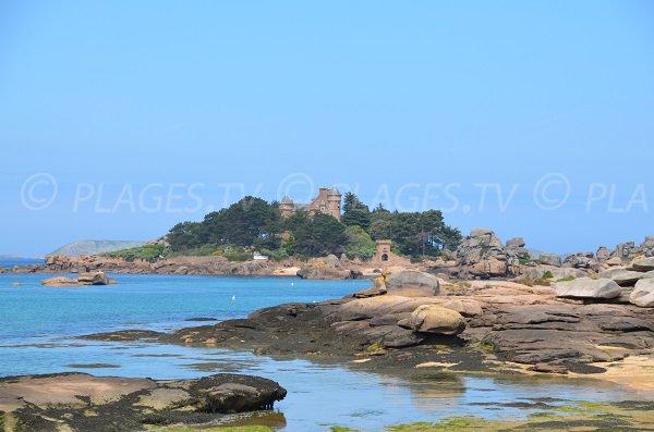 Tourony beach in Trégatel - view on castle of Costaérès